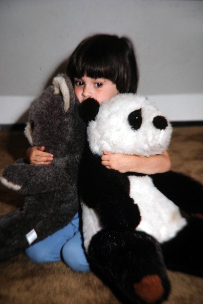 Boy-Hugging-Teddy-Bears.jpg